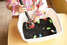 Black beans and cut out foam shapes, good way to learn shapes and colors!