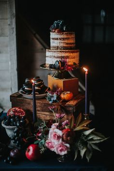 The wedding cake was a semi naked one, with blackberries and black macarons, and with various fruit and berries