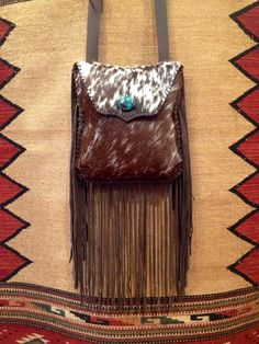 The Rocky Hill bag. Full of fringe, lined with interior pocket and closes securely with a magnetic snap. A turquoise stone adds a dash if southwest color. gowestdesigns.us