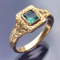 Georgian era gold ring with beautiful etched design and square emerald.