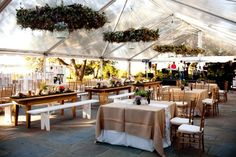 Love the burlap, different sizes of tables and of course the tent itself.