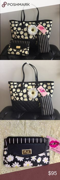 """BetseyJohnson Daisies Tote 3 in 1 set. Price is firm. Super value 3 in 1 set!  TOTE measures 13""""x 11""""x 5.5"""". Comes with a matching wallet and a small wristlet. 9"""" L double handles. Magnetic snap closure. Interior: 1 zipper compartment, 1 zip pocket and 3 slip pen pockets  Wallet: Measures 4.5"""" x 7.5"""". Easily fits larger phone such as iPhone 6 Plus and 7. Envelope style design on the front with a magnetic closure plus a golden Betsey Johnson logo. Interior: One single compartment with stripes…"""
