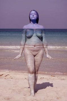 Body painting, woman at the beach.