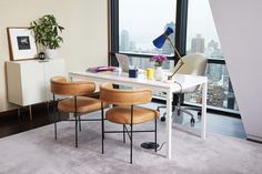HGTV Magazine Editors Have the Most Ingenious Tricks for Modernizing a Dull Office Magazine Editor, Hgtv Magazine, Marble Top Desk, Rolling Chair, Ghost Chairs, Green Sofa, Desk Areas, Black Table Lamps, Office Makeover