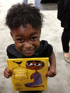 An excited fan with HARLEM'S LITTLE BLACKBIRD by Renee Watson; illustrated by Christian Robinson