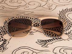 Leather eyewear tattoed by Easy Sacha. Cat Eye Sunglasses, Eyeglasses, Eyewear, Easy, Leather, Eye Tattoos, Dragon, Fashion, Glasses Frames