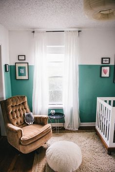 This one is pretty cozy. I like the green walls with white trim and the way the framed artwork is hung on it. The gold recliner looks surprisingly not-outdated with the pouf and the designy owl pillow. And the textured rug is a nice touch too.