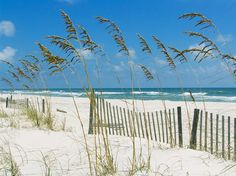 white sand & small picket fence in Pensacola, FL