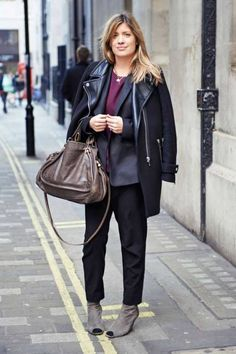 Slouchy pants and a coat with leather accents work in London #streetstyle