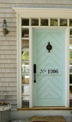 This light aqua door is a beautiful contrast to the dove grey shingles. Door hardware and house numbers add a unigue touch...