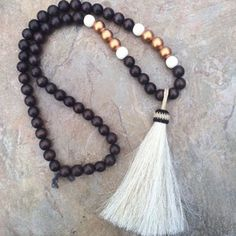 BEADED NECKLACE CHOCOLATE WITH OVERSIZED WHITE HORSEHAIR TASSEL