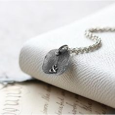 Inked Fingerprint Monogram Rounded Square Necklace. The silver is oxidised so you will be able to see the unique loops, whorls and arches of each of the individual and unique fingerprints. You decide how many prints you would like to capture, one or two, side by side.