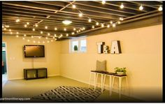 apartmenttherapy.com  post in msn.  Unfinished basement ideas