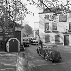 Spaniards Inn, Spaniards Road, Hampstead Heath, London, 1960-1965. Cars passing each other on the road between the Spaniards Inn and the old Toll House at the junction of Spaniards Road and Hampstead Lane.