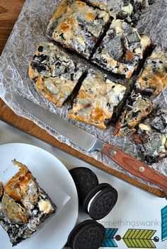 S'mOreo Seven Layer Bars | These are every bit as AMAZING as you're imagining they are! Oreos, marshmallows, Hershey bars, chocolate chips, and white chocolate chips. Yum!! Ooey gooey goodness!