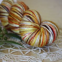 "candy corn colors in super soft and shiny superwash merino/silk:  ""maize,"" hand dyed by phydeaux.  :)"