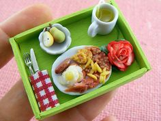 Don't these miniature meals look good enough to eat? The handmade sculptures are the work of Israeli artist Shay Aaron who seems to have the perfected the art of clay food! In fact, he's even selling these mini treats on Etsy as jewelry! Care to have a croissant and coffee necklace or salmon sushi earrings? Talk about a conversation starter...        Shay Aaron on Flickr via [Booooooom]