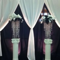 Spectacular settings LLC wedding backdrop-pull white curtains and hang hot pink behind and hang crystal chandaliers