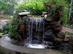 Here are some amazing and easy to make DIY garden waterfalls that are a great addition to any backyard. Whether you have a big space, or a small corner, there's a garden waterfall idea here for you. Waterfall Landscaping, Garden Waterfall, Pond Landscaping, Waterfall Fountain, Backyard Water Feature, Ponds Backyard, Water Features In The Garden, Garden Features, Waterfall Design