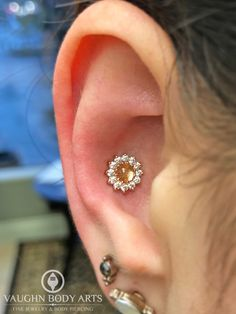 """We just can't get over how amazing these """"Rose"""" threaded ends from BVLA look! Our apprentice Brittney got to do this gorgeous conch piercing for Cynthia. Outer Conch Piercing, Conch Piercings, Body Piercing, Cute Jewelry, Body Jewelry, Jewelry Accessories, Soldering Jewelry, Nose Rings, Piercing Ideas"""
