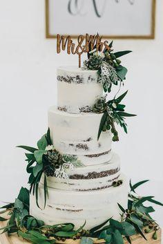 modern vintage farm wedding cake   naked cake with greenery