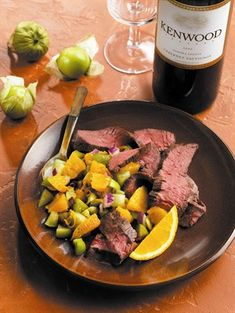 Orange-Chipotle Skirt Steaks  -- After a dip in a spicy citrus marinade, steak get grilled and topped with homemade tomatillo salsa.