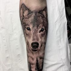 Black and grey ink realistic wolf tattoo by Fervescent