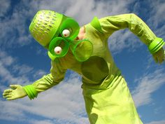 Recycled alien costume using a colander and plastic cups/plates.