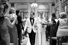 Love this groom's style! White tuxedo jacket with a classic bow tie. Photo: Chris Isham / Bride's Dress: Mendi's Creations and Melinda Waddell