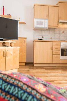 Für einen faulen Nachmittag auf der Couch sind Sie bei uns bestens ausgerüstet! 🤗 #uabkerschenbauer #hönigshof #urlaubambauernhof Kitchen Cabinets, Couch, Home Decor, Living Room, Settee, Decoration Home, Sofa, Room Decor, Cabinets
