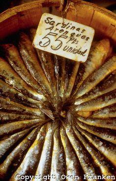 A bucket of sardines for sale, Madrid, Spain (1988). Photo: Owen Franken