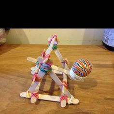 Catapult from Popsicle sticks and rubber bands. Cool mom and son project