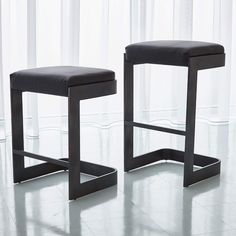 Studio A showcases the Regan Stool in Black Leather Graphite, bringing luxe elegance to your home. Attractive and functional, these chic stools are crafted fro