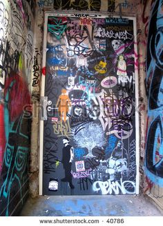 I like the variety of text, color, shapes and media on this door. stock-photo-city-graffiti-door-40786.jpg (338×470)