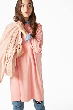 This is a long, oversized sweatshirt dress with big pockets and extra cuff detail on the sleeves, it's both comfort and style.