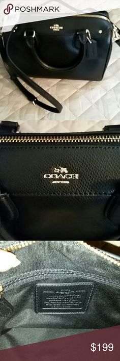 Coach purse Black Beautiful  new with tags Black and gold authentic Coach purse Measurements are 9 inches long 7 inches tall 5 inches wide handles are 4 inches tall comes with a strap Coach Bags