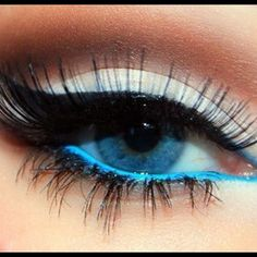 White on the lid, charcoal in the crease,  black liner on the top and electric blue on the bottom.  False eyelashes.