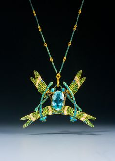 An amazing aquamarine and diamond set enamel pendant by LALIQUE depicting 4 intertwined dragonflies. (hva)