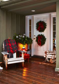 Stack two wreaths on the front door and connect them with fishing line. Add bows, birch logs, warm blankets and other hits of cheer. You can also make your own welcome bouquet by placing extra boughs and tree trimmings in a basket. We tucked in glitter stars on sticks!  Adirondack chair, acehardware.com. Red plaid throw, dashandalbert.com. Woven basket, potterybarn.com. Wreaths, glitter stars and ribbon, michaels.com.   - GoodHousekeeping.com
