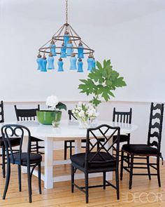 Who said you need to have matching dining chairs?! Mix it up