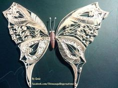 a butterfly by Endz- I sure wish I knew how they did the line parts on this butterfly! It's beautiful!