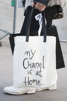 Behold, the Best Accessories From the Paris Fashion Week Style Set: This Fashion Week attendee matched her stunning colorblocked heels with coordinating pants.   : A black and white tote displayed a cheeky Chanel message.