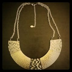 Aldo Mixed Metal Necklace Gunmetal and gold tone joined together to give this intriguing peice an old world yet fashionable look. ALDO Jewelry Necklaces