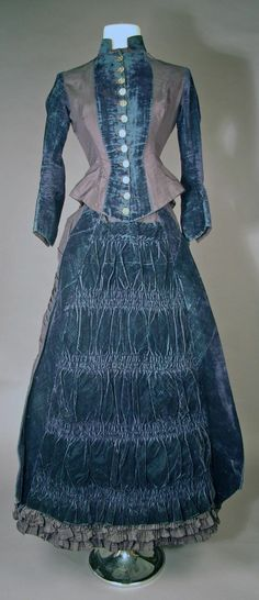 """I would say """"late Bustle Era"""" because of the style of the bodice( fitted french vest) and the detailing/rouching on the skirt. But Seller calls this """"Edwardian,  Blue Gray Satin and vibrant blue Velveteen 2 piece Suit: Bodice and Skirt, Waist 26"""", Bust 26"""""""