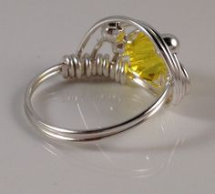 Love how this is wrapped. -Yellow Ring Twisted Ring Wire Wrap Birthstone Ring Crystal Ring Wire Wrapped Artisan Handcrafted Jewelry Handmade Jewelry ITEM0305. $14.95, via Etsy.
