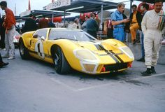 https://flic.kr/p/bcc9Sg | Bruce McLaren's Ford Mk. II at Daytona 1967 | That's the legendary Bruce McLaren on the right standing in front of his 7-liter Shelby Ford Mk. II at Daytona in 1967.  Most thought that this car or one of the other five Mk. IIs would come home a winner at Daytona since Ferrari only had two factory 4-liter prototypes at Daytona.  Unfortunately for Ford most of their cars succumbed to faulty transmissions and this car was the only Mk. II to finish.  McLaren and…