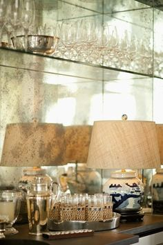 Do something visually impactful for the backsplash... go for a fun, patterned wallpaper or beautiful antiqued mirror as shown here. | Image via Pinterest, Original Source Unknown}