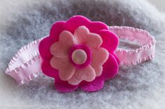 Pink and Fuchsia felt flower with a pink pearly button center and a gentle stretch elastic band on Etsy, $4.00 CAD