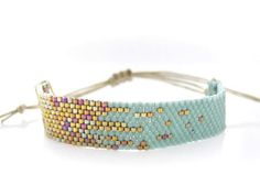 Peyote stitch using mint and gold seed beads; You see how important color choice is in beaded jewelry