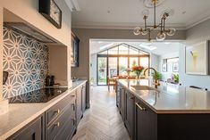 We are lucky at Herringbone Kitchens to have clients with amazing style. This bespoke kitchen extension in Surrey is hand painted in Mylands Bond Street and finished with brass handles from Armac Martin. We have had so much fun working on this project and Studio Kitchen, New Kitchen, Kitchen Decor, Kitchen Ideas, Kitchen Taps, Green Kitchen, Kitchen Designs, Open Plan Kitchen Living Room, Kitchen Dining Living